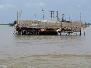 Tonle Sap Lake – Phnom Penh (B, L)